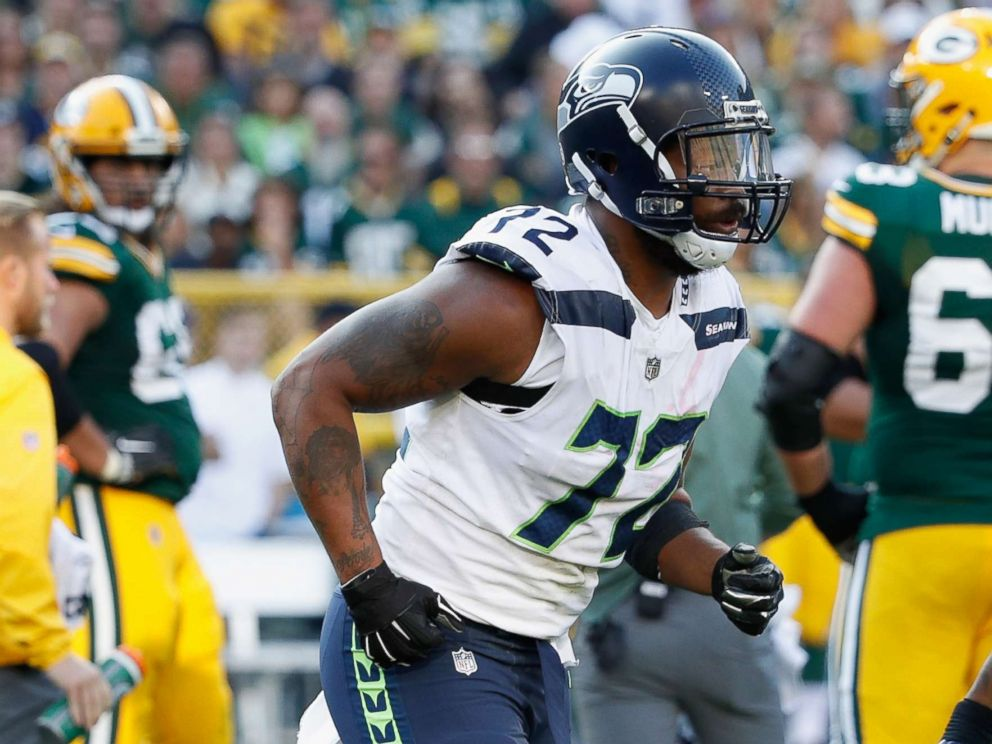Martellus Bennett Raises Fist During National Anthem, Michael Bennett Protests By Sitting