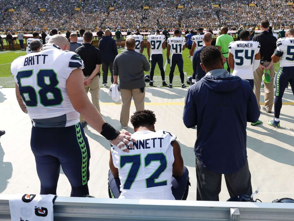 PHOTO: Seattle Seahawks Michael Bennett remains seated on the bench during the national anthem before an NFL football game against the Green Bay Packers Sunday, Sept. 10, 2017, in Green Bay, Wis.