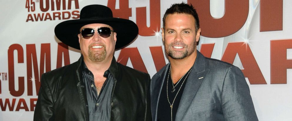 PHOTO: Eddie Montgomery, left, and Troy Gentry of Montgomery Gentry arrive at the 45th Annual CMA Awards in Nashville, Tenn., Nov. 9, 2011.