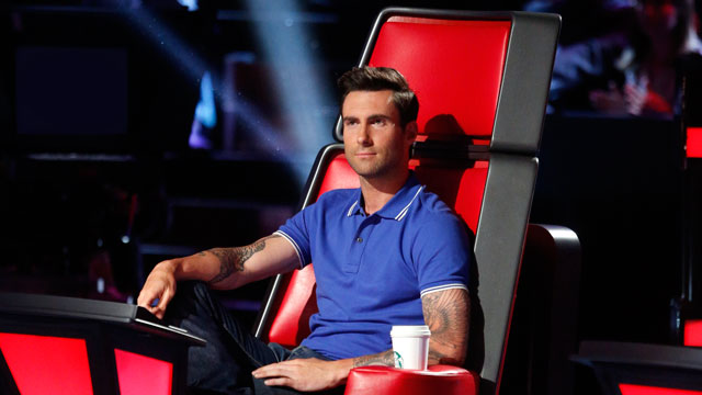 PHOTO: Adam Levine listens as contestants perform on The Voice, May 28, 2013.