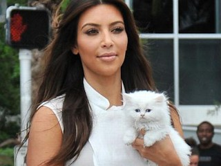 Photos: Kim Kardashian Adopts
