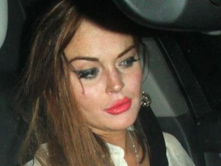 Photos: Lohan Over-Primps for Party