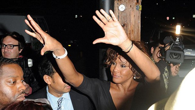 PHOTO: Whitney Houston waves to the crowd looking worse for wear last night in Hollywood, California after enjoying a party with friends, Feb. 9, 2012.
