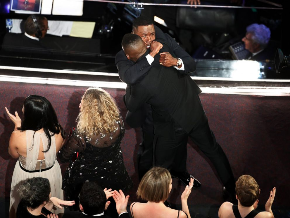 PHOTO: Moonlight castmembers Mahershala Ali and Trevante Rhodes hug after it was announced that the movie won Best Picture during the telecast of the 89th Academy Awards on Feb. 26, 2017 in Hollywood, Calif.