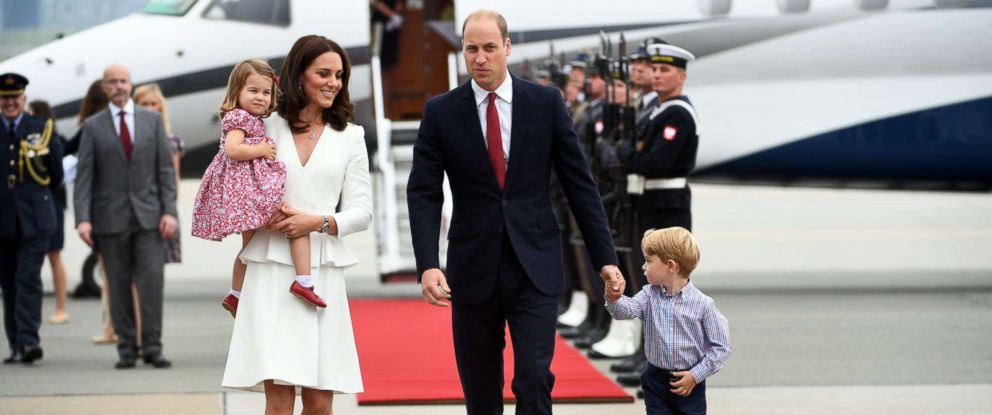 PHOTO: Prince William and Catherine, Duchess of Cambridge with their children Prince George and Princess Charlotte arrive at the airport in Warsaw, Poland, July 17, 2017.