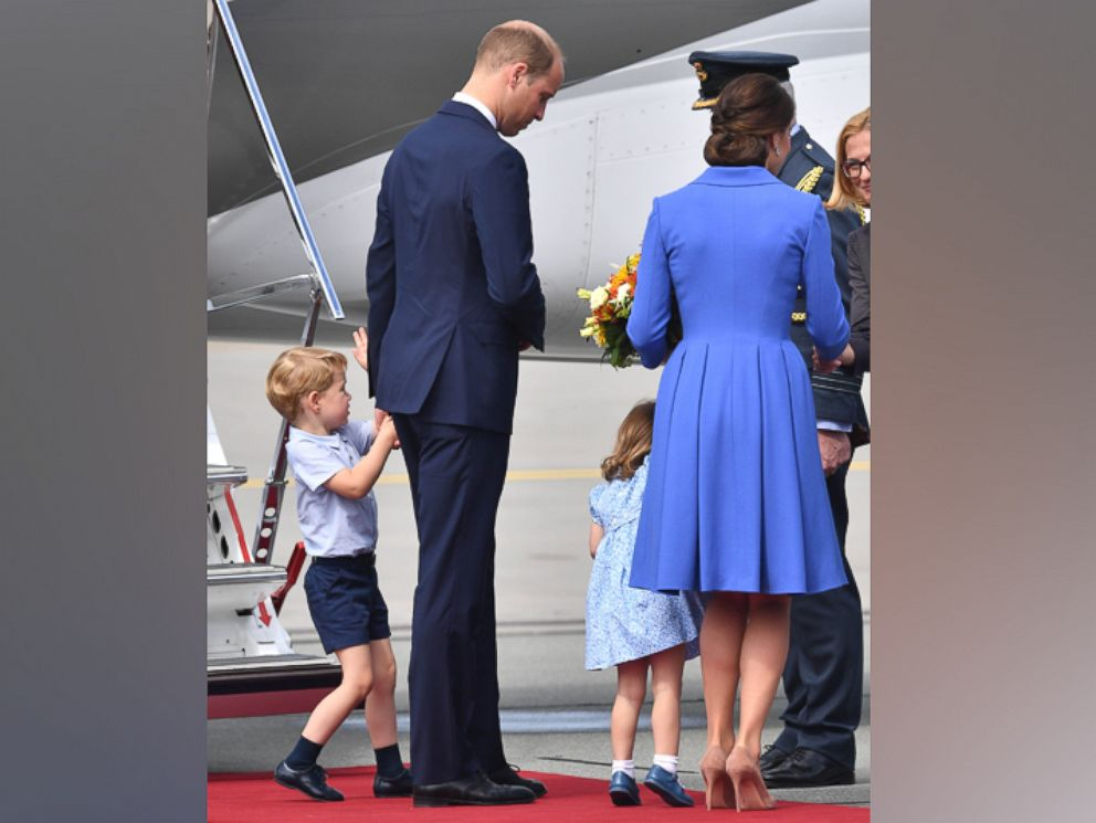 PHOTO: Prince William, Catherine The Duchess of Cambridge with their children Prince George and Princess Charlotte depart Warsaw airport in Poland after a three day visit, July 19, 2017.