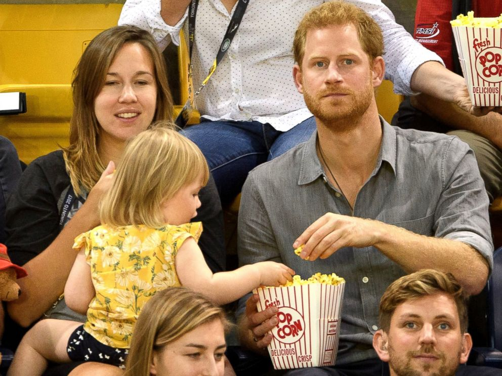 PHOTO: Prince Harry watches seated volleyball with Dave Henson, his wife Hayley Henson, and their two-year-old daughter Emily from the stands during the Invictus Games at the Mattamy Athletics Center, Sept. 27, 2017 in Toronto.
