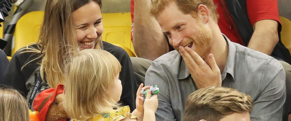 PHOTO: Prince Harry (R) sits with David Hensons wife Hayley Henson (L) and daugther Emily Henson at the Sitting Volleyball Finals during the Invictus Games 2017 at Mattamy Athletic Center, Sept. 27, 2017 in Toronto.