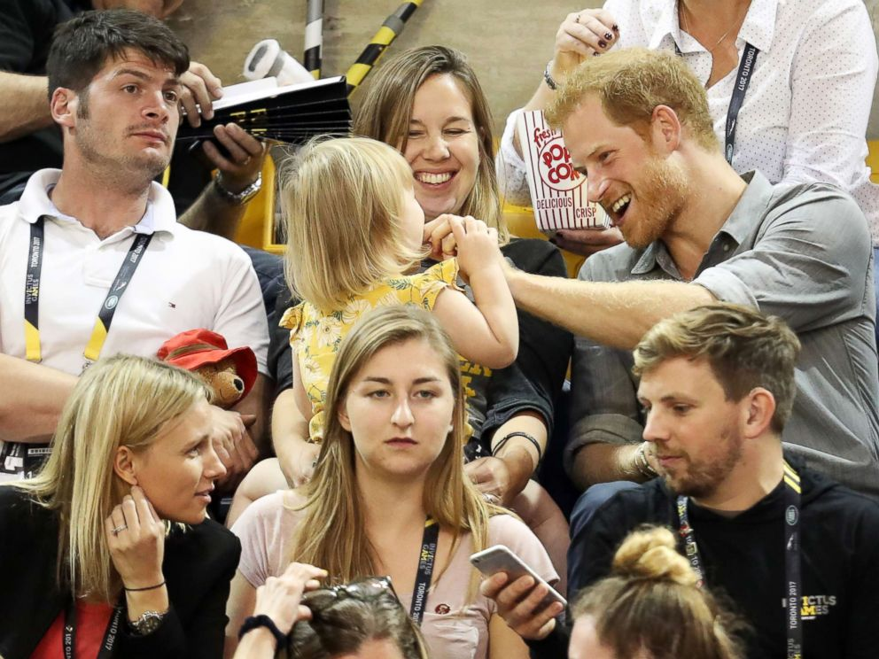 PHOTO: Athlete David Henson (L), wife Hayley Henson, and daughter Emily Henson sit with Prince Harry at the Sitting Volleyball Finals during the Invictus Games 2017 at Mattamy Athletic Center, Sept. 27, 2017 in Toronto.