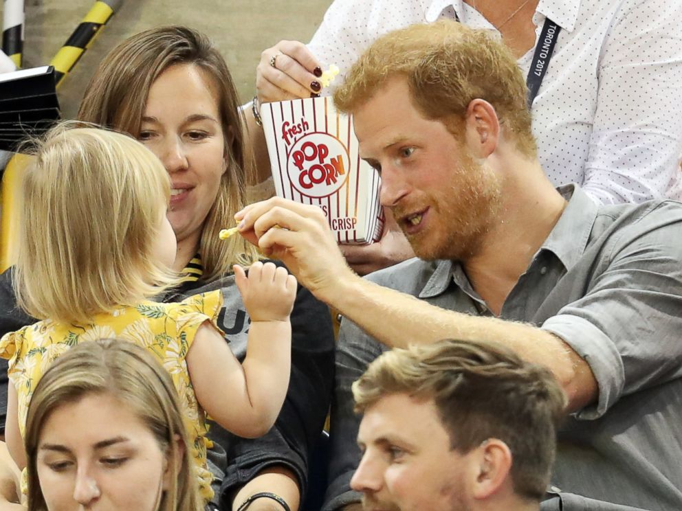PHOTO: Prince Harry (R) sits with David Hensons wife Hayley Henson (L) and daughter Emily Henson at the Sitting Volleyball Finals during the Invictus Games 2017 at Mattamy Athletic Center, Sept. 27, 2017 in Toronto.