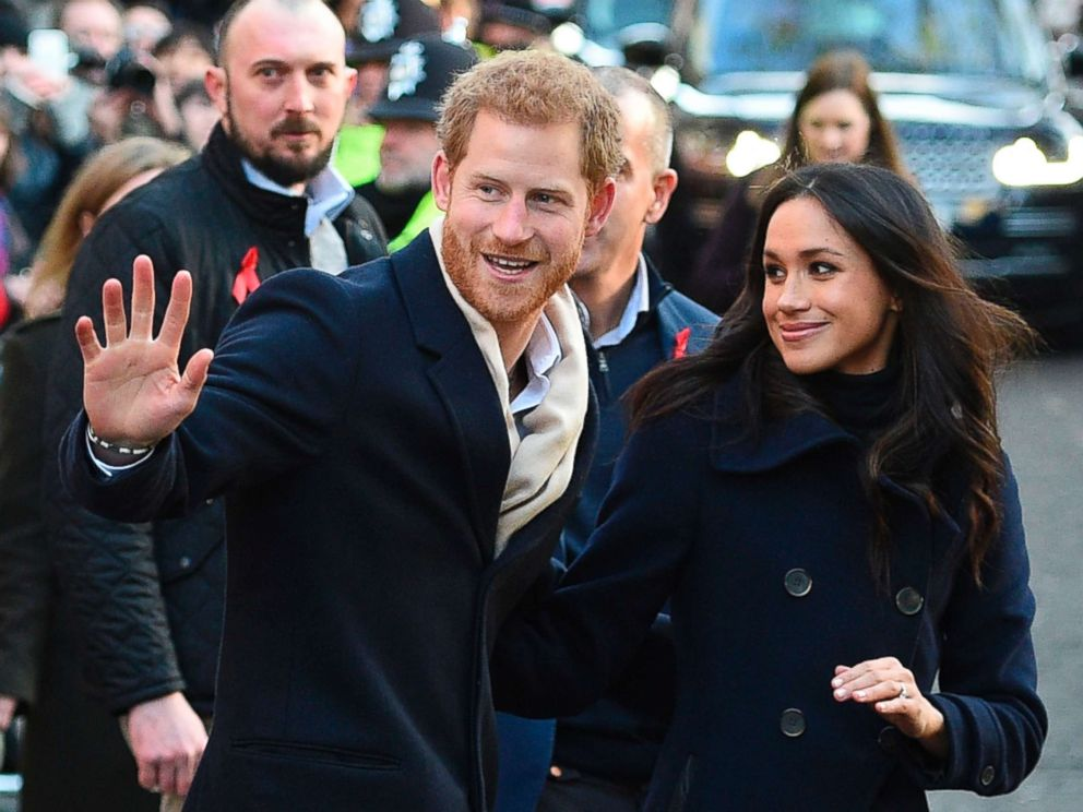PHOTO: Britains Prince Harry and his fiancee US actress Meghan Markle greet wellwishers on a walkabout as they arrive for an engagement at Nottingham Contemporary in Nottingham, England, Dec. 1, 2017.