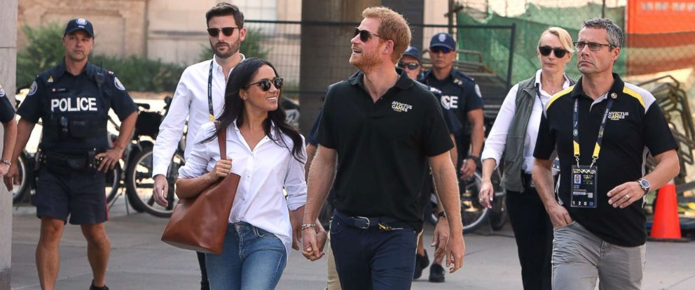 prince harry meghan markle step out holding hands at