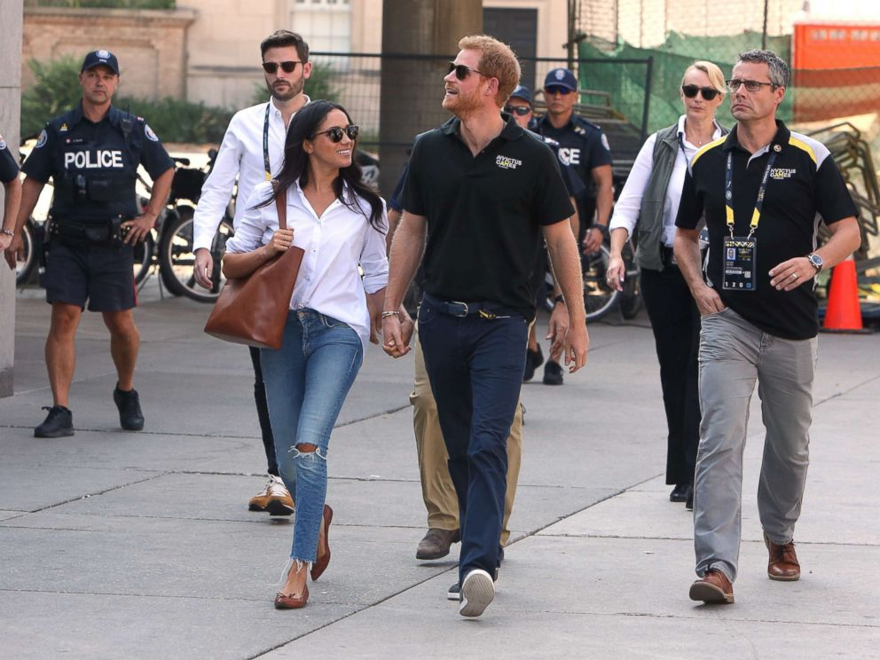 PHOTO: Prince Harry and Meghan Markle attend the wheelchair tennis event together at the Invictus Games in Toronto, Sept. 25, 2017. <p itemprop=