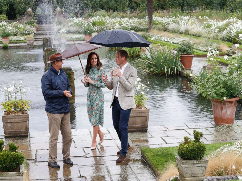 PHOTO: Britains Prince William, and his wife Kate, Duchess of Cambridge are given a tour at the memorial garden in Kensington Palace, London, Aug. 30, 2017.