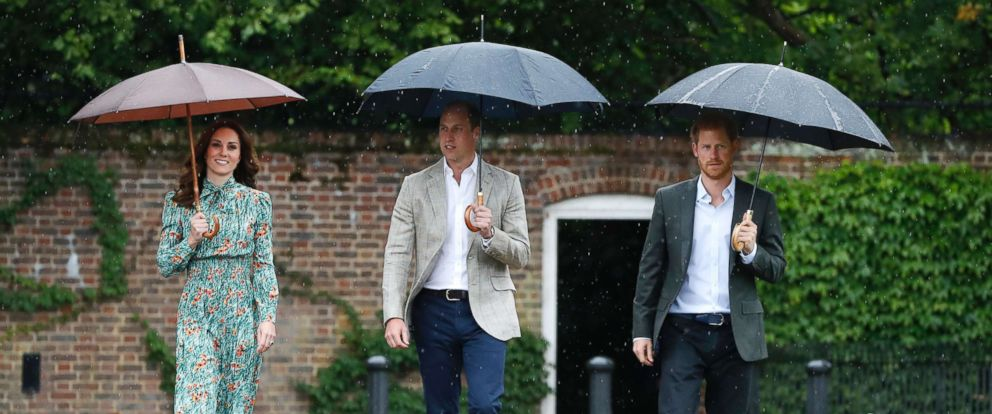 PHOTO: Britains Prince William, Kate, Duchess of Cambridge and Prince Harry arrive for an event at the memorial garden in Kensington Palace, London, Aug. 30, 2017.
