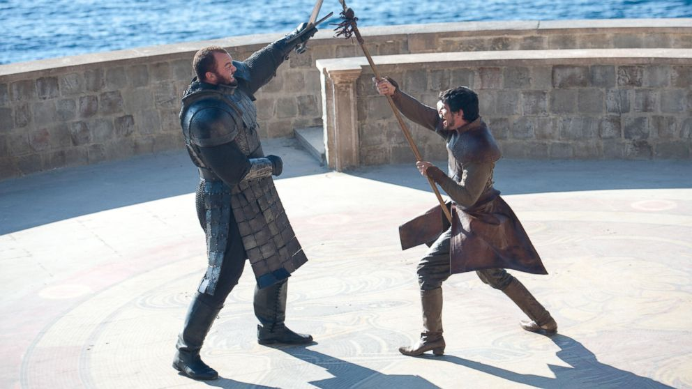"""PHOTO: The Mountain (Hafthor Julius Bjornsson) squares off against Oberyn Martell (Pedro Pascal) on the HBO show, """"Game of Thrones""""."""