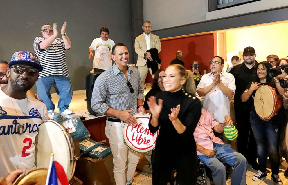 PHOTO: Jennifer Lopez and Alex Rodriguez play music with people in Puerto Rico.