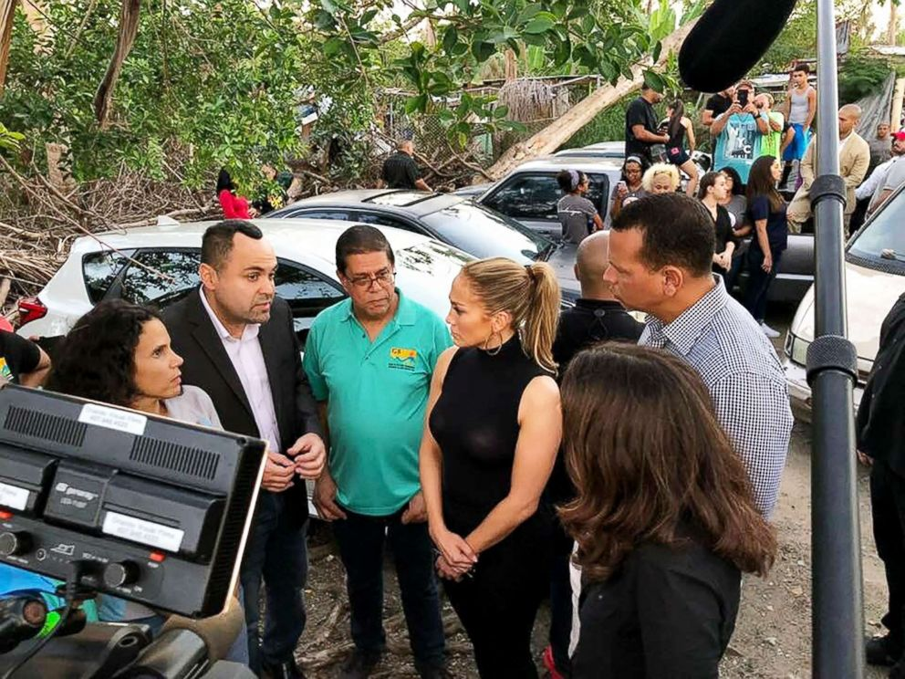 PHOTO: Jennifer Lopez and Alex Rodriguez talk with residents of Puerto Rico about the islands recovery from Hurricane Maria.