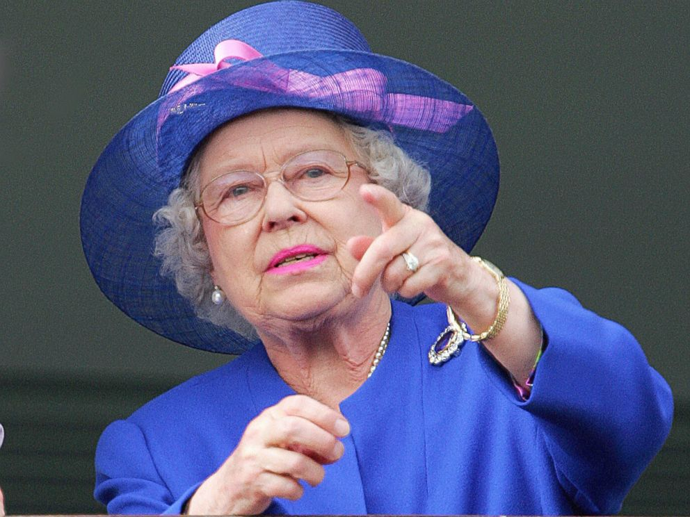 PHOTO: Queen Elizabeth II gestures as Jockey Frankie Detorri crosses the finish line to win the Vodafone Derby at the annual Vodafone Derby horse race at Epsom Downs, Surrey, June 2, 2007.