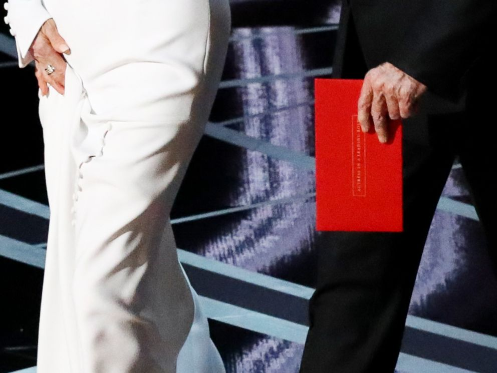 PHOTO: Warren Beatty carries an envelope reading Actress in a Leading Role as he walks on stage with Faye Dunaway to present the Oscar for Best Picture during the 89th Academy Awards in Los Angeles, Feb. 26, 2017.