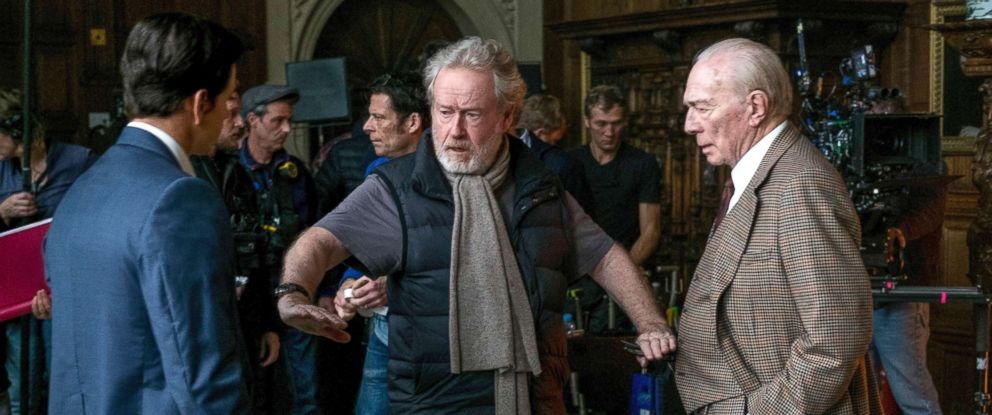 """PHOTO: Mark Wahlberg, left, and Christopher Plummer, right, listening to director Ridley Scott on the set of """"All The Money In The World."""""""