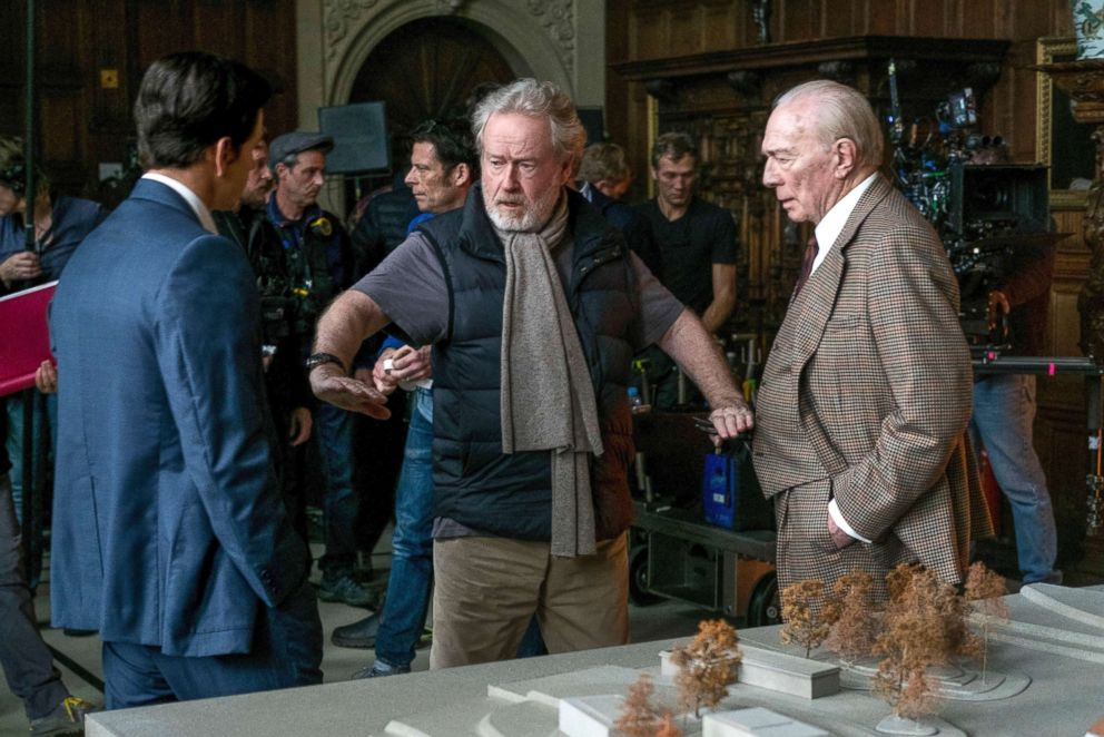 PHOTO: Mark Wahlberg, left, and Christopher Plummer, right, listening to director Ridley Scott on the set of All The Money In The World.