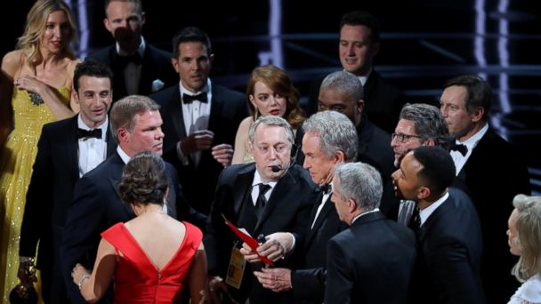 PHOTO: Warren Beatty holds the card for the Best Picture Oscar awarded to