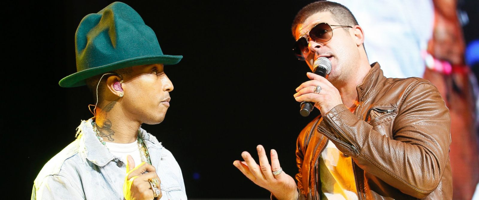 PHOTO: Pharrell Williams and Robin Thicke perform together at the Walmart annual shareholders meeting in Fayetteville, Ark., June 6, 2014.