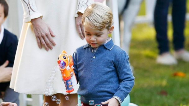 PHOTO: Prince George plays with a bubble gun at a children's party at Government House in Victoria, British Columbia, Canada, Sept. 29, 2016.