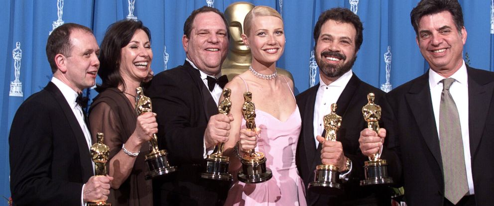 """PHOTO: """"Shakespeare in Love Best Actress winner Gwyneth Paltrow (center) is joined by Harvey Weinstein (center left) and other stars as they celebrated their win of Best Picture at the 1999 Academy Awards in Hollywood, Calif., March 21, 1999."""