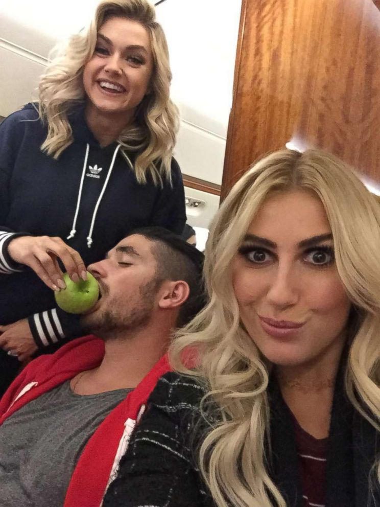 PHOTO: Emma Slater took a selfie while Lindsay Arnold fed Alan Bersten an apple on their flight.
