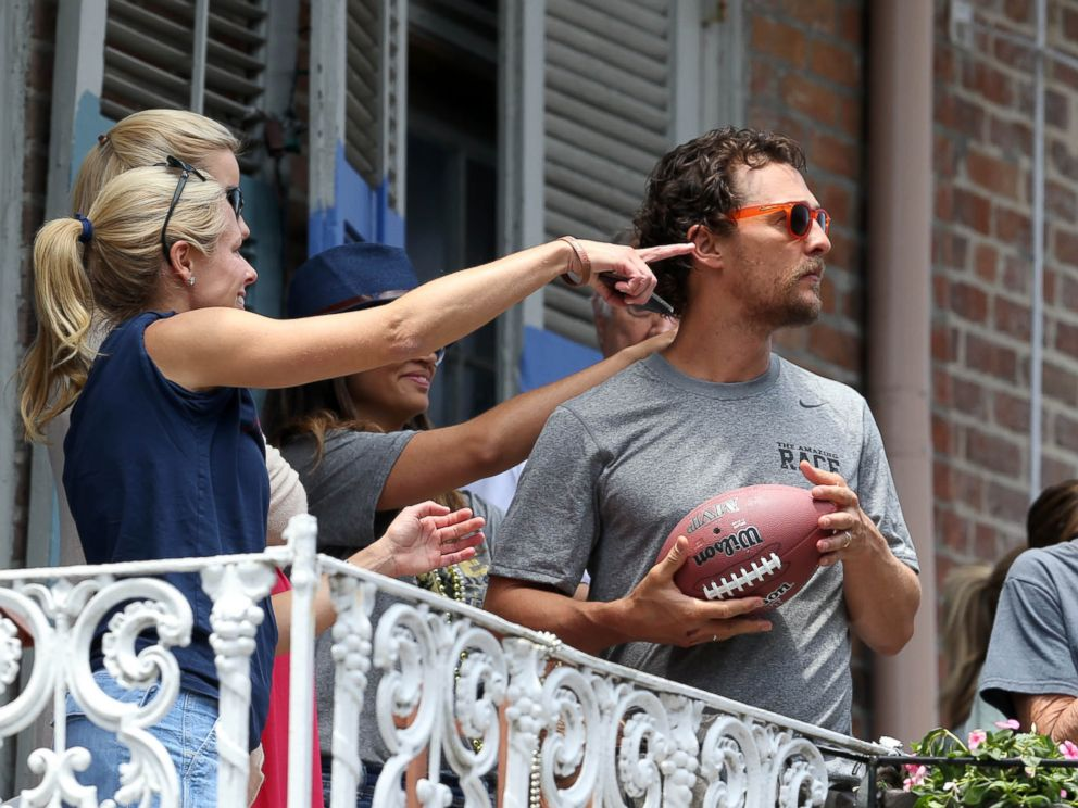 PHOTO: Brad Pitt and Matthew McConaughey chat with each other across balconies while McConaughey and his family participate in The Brees Dream Foundation charity fundraiser in New Orleans, Louisiana, May 17, 2014.