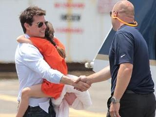 Photos: Tom Cruise Whisks Suri Away