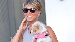 Kaley Cuoco Gives Her Dog Ruby a Lift