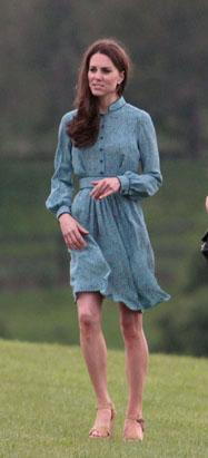 Kate Dazzles Crowd with Teal Dress