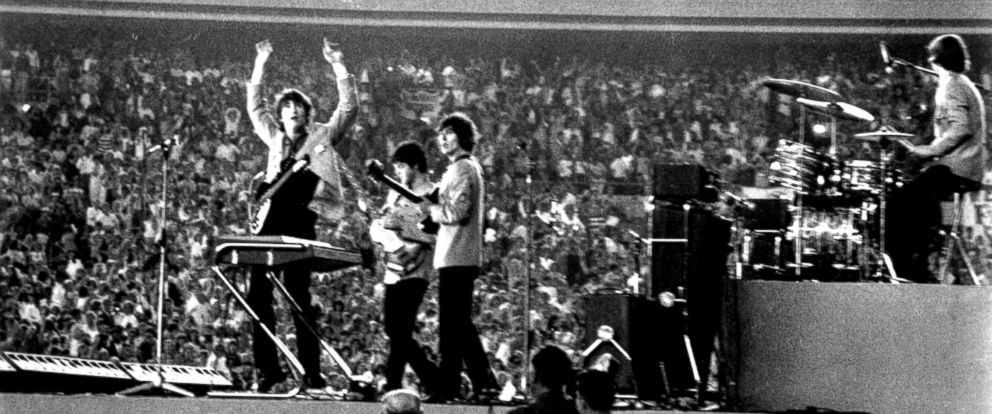 PHOTO: The Beatles perform at Shea Stadium, August 15, 1965, in New York City.