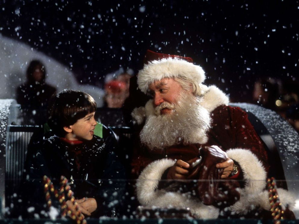 PHOTO: Tim Allen on a sled talking with Eric Lloyd in a scene from the film The Santa Clause, 1994.