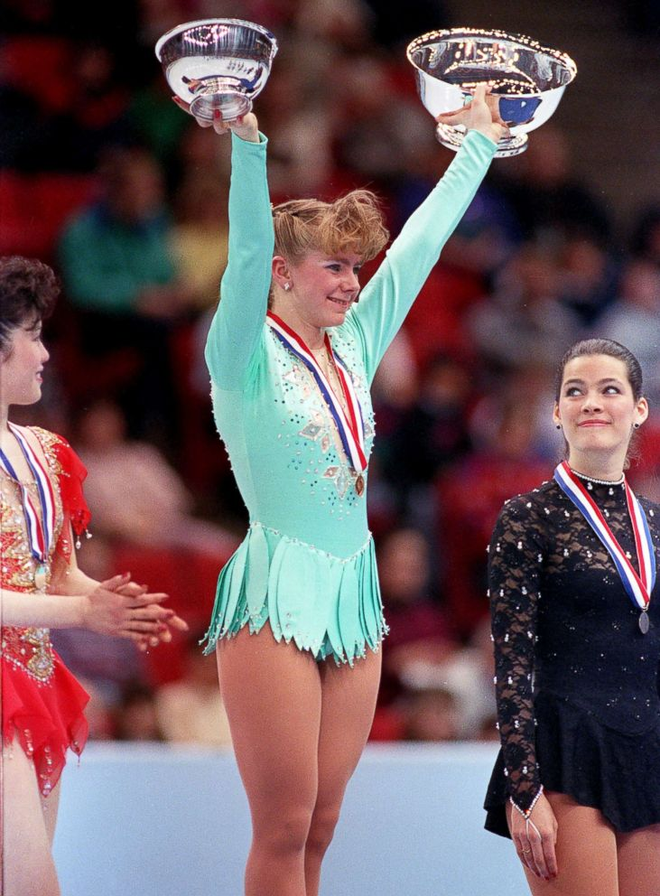 PHOTO: Tonya Harding of Portland, Ore., raises her trophies after winning the U.S. Figure Skating Championship in Minneapolis, Feb. 16, 1991. At left is Kristi Yamaguchi, with third place Nancy Kerrigan at right.