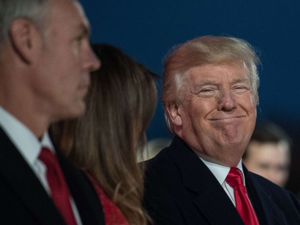 PHOTO: President Donald Trump smiles as Secretary of the Interior Ryan Zinke looks on during the 95th annual National Christmas Tree Lighting ceremony in Presidents Park near the White House in Washington on Nov. 30, 2017.