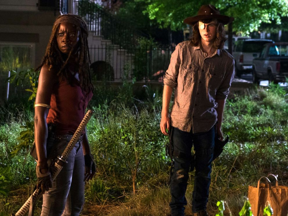 Carl Grimes and Danai Gurira as Michonne in an episode from The Walking Dead