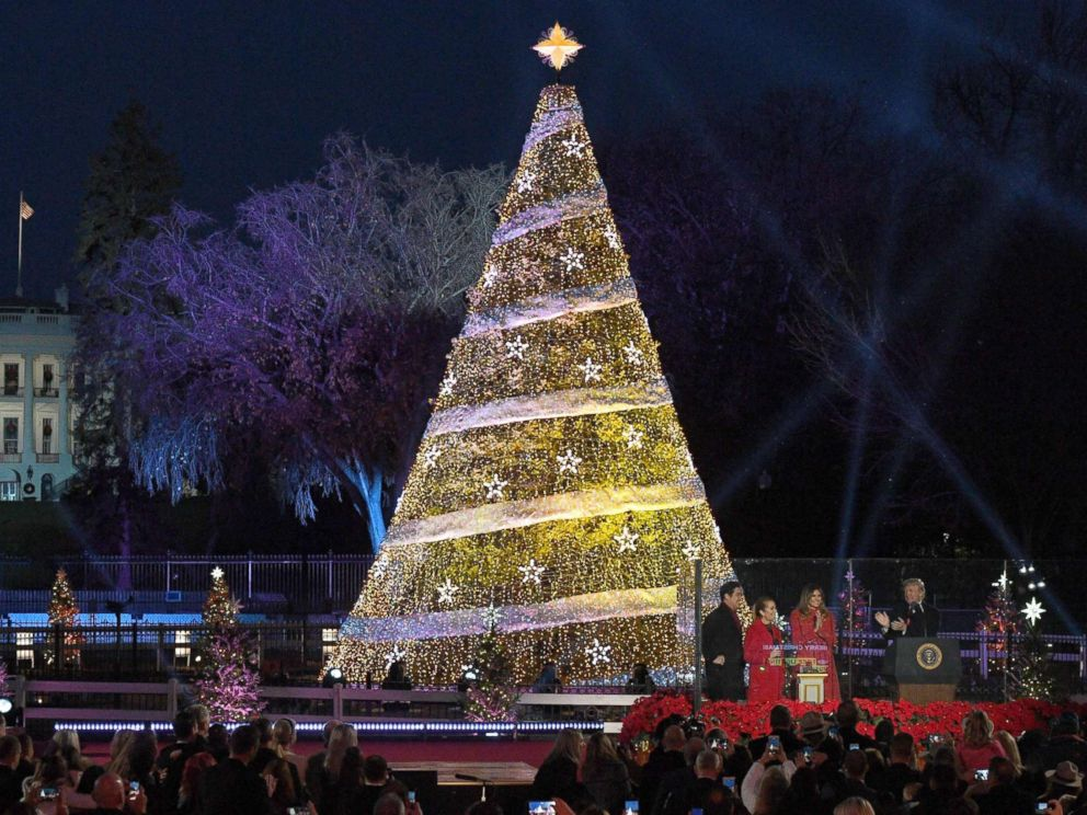 PHOTO: US President Donald Trump claps next to First Lady Melania Trump during the 95th annual National Christmas Tree Lighting ceremony at the Ellipse in Presidents Park near the White House in Washington on November 30, 2017.