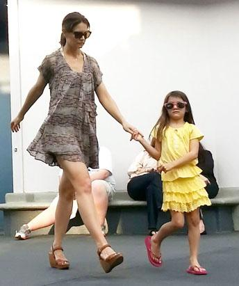 Katie Comforts Suri