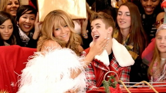 VIDEO: Mariah Carey cozies up with Justin Bieber in All I Want for Christmas music video.