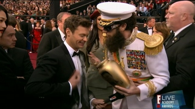 VIDEO: Sacha Baron Cohen dumped ashes on Ryan Seacrest during E! interview.
