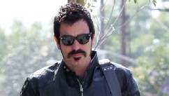 PHOTO: Ewan McGregor is unrecognizable as he debuts new jet black hair and matching mustache after a day at the salon in Los Angeles, May 21, 2013.