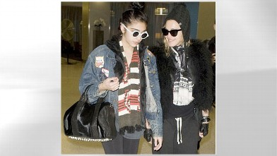 PHOTO: Madonna dresses in a rather immature manner as she accompanies daughter Lourdes at JFK Airport in New York City.