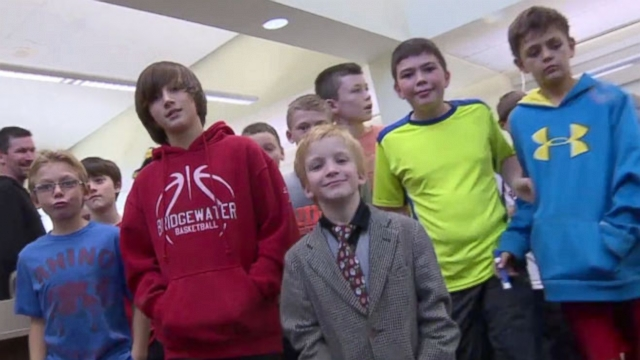 VIDEO: Football team at elementary school stand up for waterboy picked on for speech disorder.