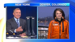"Ginger Zee receives the ceremonial galoshes as the ""GMA"" meteorologist."