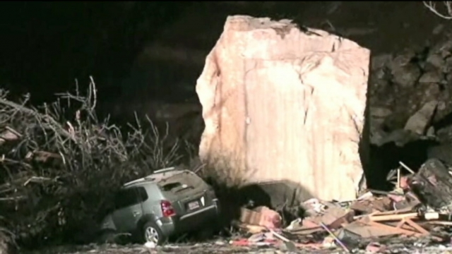 Officials still dont know exactly what caused boulders to break free and slide into a neighborhood.