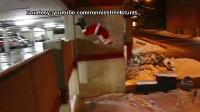 Stuntman Ronnie Shalvis dresses as Santa for extreme gift-delivering.